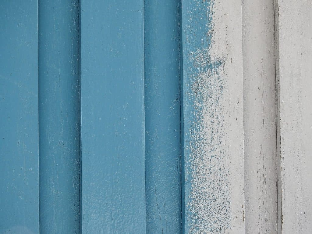 acrylic paint on wooden fence